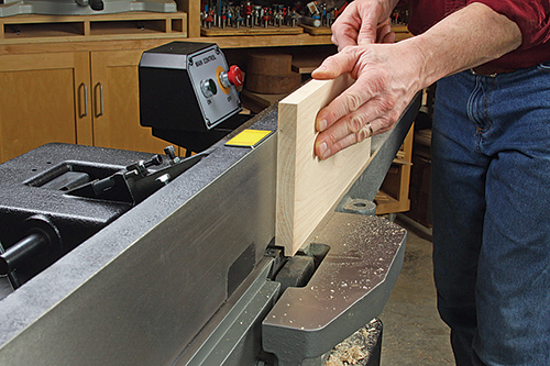 Although it's seldom mentioned, jointers can cut rabbets, too. A small outboard table under the guard will help support board faces for this purpose.