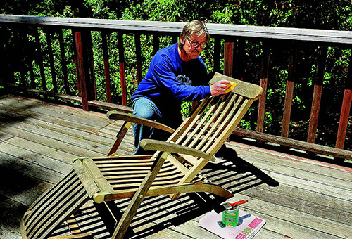 Applying finish to a wood deck chair
