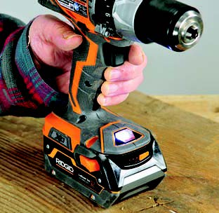 A light touch on the long flat button on the RIDGID drill's grip activates the two bright LED lights located in the base.
