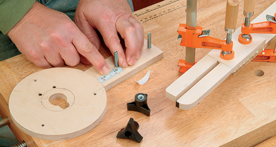 A short length of stick-on measuring tape allows fine-tuning of the distance between the jigsaw blade (or router bit) and the jig's pivot hole.