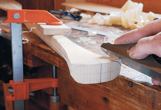 7. Shape the radius corners with a block plane. Work in from the end of the handle to prevent chipping on the edges. Continue shaping the handle with a combination of the block plane, spokeshave and carving knives.