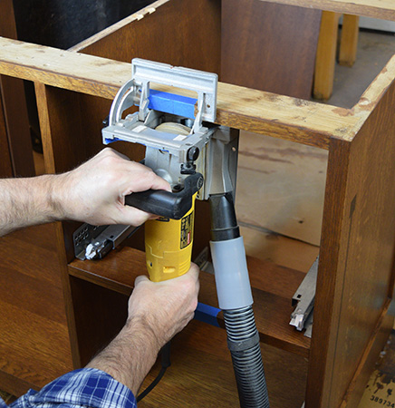 Cutting biscuit slot in Limbert hutch cabinet frame