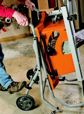 To set up or store RIDGID's rolling base, step on a foot release and pivot the handles up or down. The action is well-balanced and easy.