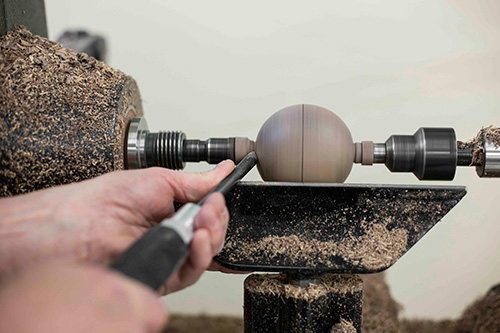 Using a spindle gouge to finish turning a sphere