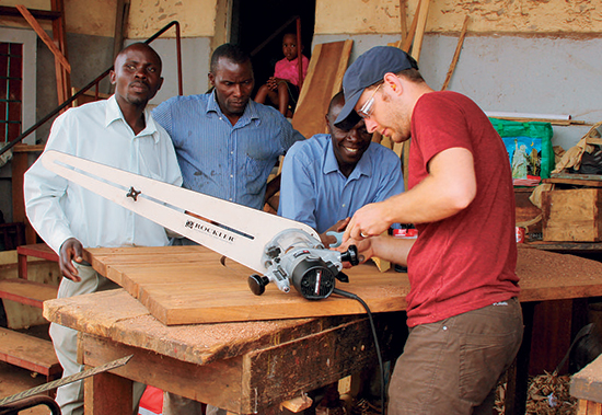 A crowd of craftsmen who had never seen a circle jig used with a router observed Brice's setup.